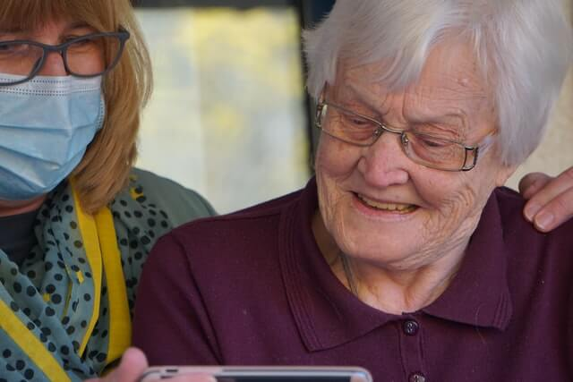 opening a care home - elderly people using phone