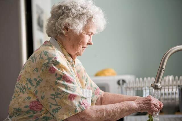 care home health and safety - woman washing hand